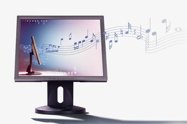 notas musicais saindo da tela de um computador